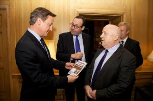 The Prime Minister, Richard Harrington MP and Nik reviewing My Watford News