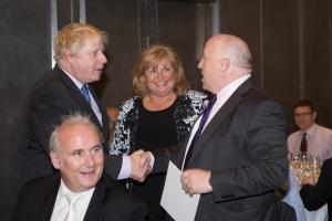 Mayor Boris Johnson and Nik testing each other's grip.
